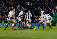 Watford's Will Hughes (centre) is tackled by Brighton & Hove Albion's Lewis Dunk in front of the Brighton & Hove Albion goal<br /> <br /> <br /> Photographer David Horton/CameraSport<br /> <br /> The Premier League - Brighton and Hove Albion v Watford - Saturday 2nd February 2019 - The Amex Stadium - Brighton<br /> <br /> World Copyright © 2019 CameraSport. All rights reserved. 43 Linden Ave. Countesthorpe. Leicester. England. LE8 5PG - Tel: +44 (0) 116 277 4147 - admin@camerasport.com - www.camerasport.com