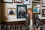 Mairead Fernane, the first female Chairperson of Austin Stacks GAA Club  with a photo of her father, Gary Fernane who was served a the Juvenile chairman of the club.