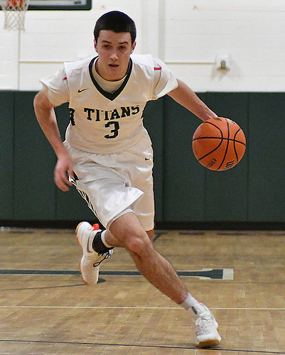 Thornton Scott #3 of Holy Trinity dribbles downcourt during a Nassau-Suffolk CHSAA varsity boys basketball game against St. John the Baptist at Holy Trinity High School on Friday, Feb. 3, 2017. He drained five three-pointers in the first half.