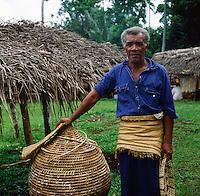 Tongan man showing basket making handicrafts, Nuku'lofa, Tonga, South Pacific, 1980.