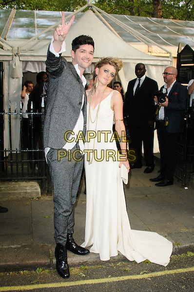 Danny O'Donoghue and Bo Bruce.Women Of The Year 2012 - Glamour Awards, Berkeley Square, London, England..29th May 2012.full length dress suit shirt white grey gray  hand v peace sign arm in air.CAP/CJ.©Chris Joseph/Capital Pictures.