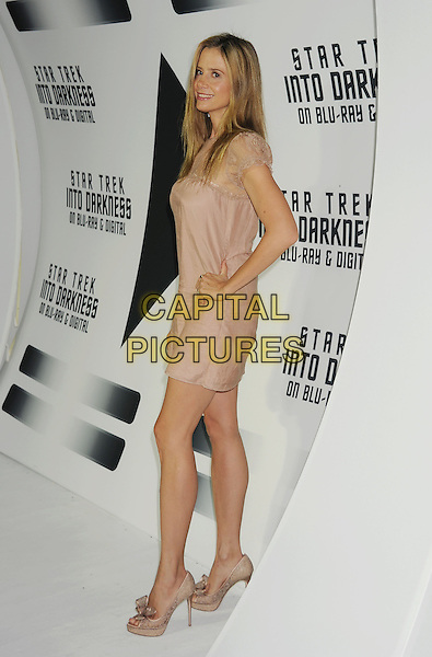 Mira Sorvino<br /> &quot;Star Trek Into Darkness&quot; DVD/Blu-Ray Release held at the California Science Center, Los Angeles, California, USA.<br /> September 10th, 2013<br /> full length dress beige lace side hand on hip<br /> CAP/ROT/TM<br /> &copy;Tony Michaels/Roth Stock/Capital Pictures