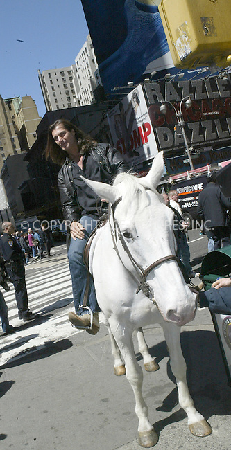 WWW.ACEPIXS.COM . . . . .  ....NEW YORK, APRIL 14, 2005....Fabio rides a horse in Times Square to promote the Oxygen Chanel's 'Mr. Romance.'....Please byline: Ian Wingfield - ACE PICTURES..... *** ***..Ace Pictures, Inc:  ..Craig Ashby (212) 243-8787..e-mail: picturedesk@acepixs.com..web: http://www.acepixs.com