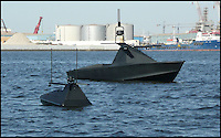 BNPS.co.uk (01202 558833).Pic: AlSeer/BNPS..***Please Use Full Byline***..Oscar and Sea Serpent on trials...The Drones have now moved onto the water - Radar proof unmanned aquatic 'stealth' boats...If you see one of these floating menacingly towards you, the advice is to get far away from it as quickly as possible...This daunting 35ft vessel belongs to the world's first fleet of unmanned 'robo-boats', designed to thwart pirates and take on dangerous covert missions without endangering the lives of crew...Looking like a cross between a miniature Navy warship and a stealth bomber, they are the waterborne equivalent of the unmanned drone planes used by the UK and US militaries in the fight against terror...The Eclipse unmanned surveillance vessels can operate 24 hours a day, travel at 60mph and can be kitted out with enough weaponry to blow adversaries out of the.water...The cutting edge boats boast state-of-the-art technology that allows it to undertake search and rescue missions or patrol dangerous waters without requiring crew...They have a range of up to 600 miles and can loiter at low speeds for 10 days without refuelling...Powered by two 500 horsepower water jets made by Rolls Royse, the Eclipse range also boast £650,000 giroscopic HD cameras which take pictures of their surroundings, analysing them for potential threats and and relaying.information back to a manned control station.