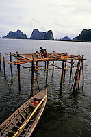 Men constructing a pile dwelling, Phang Nga Bay, Thailand.