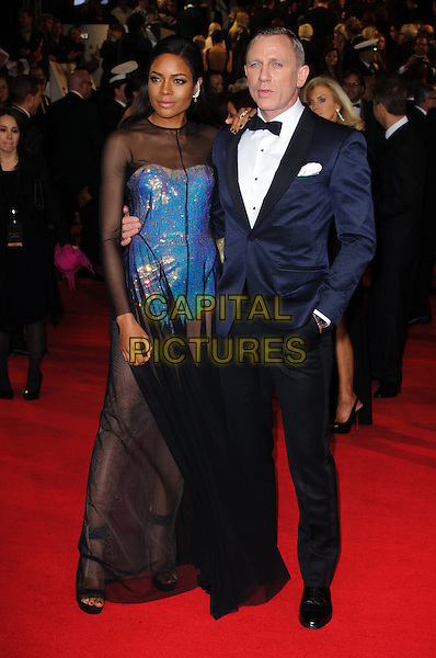 Naomie Harris and Daniel Craig.Royal World Premiere of 'Skyfall' held at the Royal Albert Hall, London, England..October 23rd, 2012.full length black white blue leotard strapless sheer dress tuxedo shirt.CAP/CJ.©Chris Joseph/Capital Pictures.
