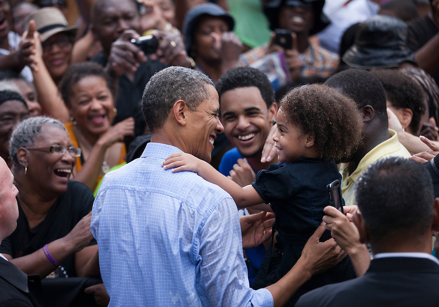 U.S. President Barack Obama greets the crowd after speaking at a campaign rally in Glen Allen, Virginia.