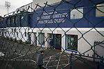 Southend United 1 Burton Albion 1, 22/02/2016. Roots Hall, League One. A woman walking past the main entrance to Roots Hall stadium, pictured before Southend United took on Burton Albion in a League 1 fixture. Founded in 1906, Southend United moved into their current ground in 1955, the construction of which was funded by the club's supporters. Southend won this match by 3-1, watched by a crowd of 6503. Photo by Colin McPherson.