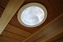 This solar tube skylight produced by Solatube International, Inc. cuts daytime energy usage by providing diffuse daylighting harnessing the sun's rays. The adjacent bamboo I-beams were designed by the SCU Solar Decathlon Civil Engineering Team. Bamboo grows quickly and can be sustainably harvested.<br /> <br /> Image size: 4368 x 2912 pixels