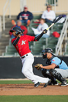 Johan Cruz (1) of the Kannapolis Intimidators follows through on his swing against the Hickory Crawdads at Kannapolis Intimidators Stadium on April 10, 2016 in Kannapolis, North Carolina.  The Intimidators defeated the Crawdads 10-3.  (Brian Westerholt/Four Seam Images)
