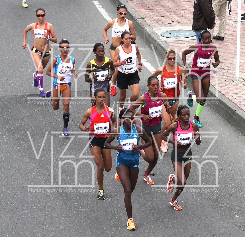 BOGOTA -COLOMBIA, 28-SEPTIEMBRE-2014. La Etiope Belaynesh Oljira gano la Carrera de la Mujer  en la cual  participaron unas 18.000 mujeres. / The Ethiopian Belaynesh Oljira won the women's race in which some 18,000 women participated.<br /> .Photo / VizzorImage / Felipe Caicedo / Staff