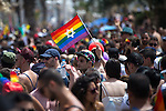 "© Licensed to London News Pictures . 03/06/2016 . Tel Aviv , Israel . A rainbow flag with a Star of David in the centre . Over 100,000 people attend the gay pride parade in Tel Aviv , reported to be the largest such event in the Middle East and Asia . The Israeli government has been accused of using the event as "" pinkwashing "" , marketing the event in order to deflect accusations of poor human rights behaviour . Photo credit: Joel Goodman/LNP"