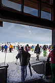 USA, California, Mammoth, a view of several skiers and snowboarders as they exit the lodge at Mammoth Ski Resort