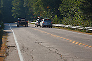 Tourists pull off along the Kancamagus Highway (route 112 to view a moose on the side of the road in the White Mountains, New Hampshire USA