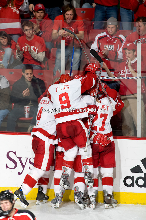MADISON, WI - DECEMBER 1: The Wisconsin Badgers men's hockey team celebrates a goal against the St. Cloud State Huskies at the Kohl Center on December 1, 2007, in Madison, Wisconsin. The Badgers beat the Huskies 4-3 . (Photo by David Stluka)