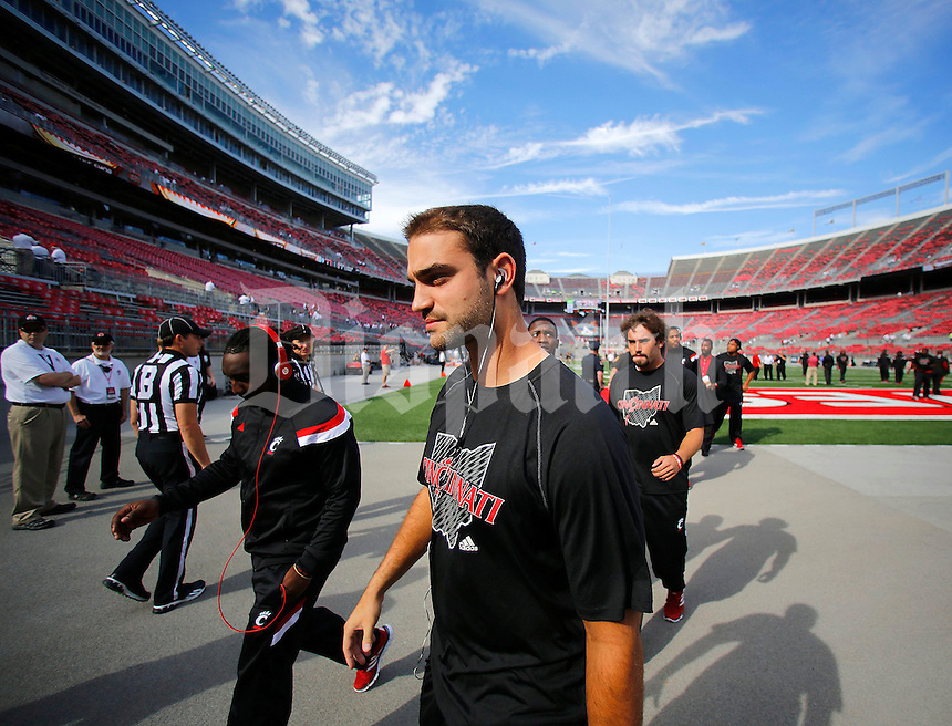 The Cincinnati Bearcats football team heads to the locker room prior to Saturday's NCAA Division I football game at Ohio Stadium in Columbus on September 27, 2014. (Columbus Dispatch photo by Jonathan Quilter)