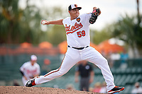 Baltimore Orioles relief pitcher Luis Ortiz (59) delivers a pitch during a Grapefruit League Spring Training game against the Tampa Bay Rays on March 1, 2019 at Ed Smith Stadium in Sarasota, Florida.  Rays defeated the Orioles 10-5.  (Mike Janes/Four Seam Images)