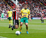 Paul Coutts of Sheffield Utd brought down by Yanic Wildschut of Norwich City during the Championship match at Bramall Lane Stadium, Sheffield. Picture date 16th September 2017. Picture credit should read: Simon Bellis/Sportimage
