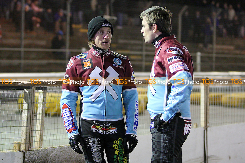 Lakeside riders Adam Shields (L) and Phil Morris discuss track conditions after Leigh Lanham of Ipswich is badly injured in a crash in Heat 8 - Ipswich Witches vs Lakeside Hammers - Speedway Challenge Match First Leg at Foxhall Stadium, Ipswich, Suffolk - 19/03/09 - MANDATORY CREDIT: Gavin Ellis/TGSPHOTO - Self billing applies where appropriate - 0845 094 6026 - contact@tgsphoto.co.uk - NO UNPAID USE.