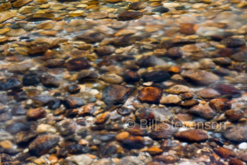A photo of rocks in a stream in Yosemite National Park, CA.