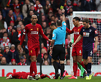 7th March 2020; Anfield, Liverpool, Merseyside, England; English Premier League Football, Liverpool versus AFC Bournemouth; Callum Wilson of Bournemouth is shown the yellow card by referee Paul Tierney after his foul on James Milner of Liverpool