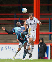 Adebayo Akinfenwa of Wycombe Wanderers & Jake Gallagher of Aldershot Town during the pre season friendly match between Aldershot Town and Wycombe Wanderers at the EBB Stadium, Aldershot, England on 22 July 2017. Photo by Andy Rowland.