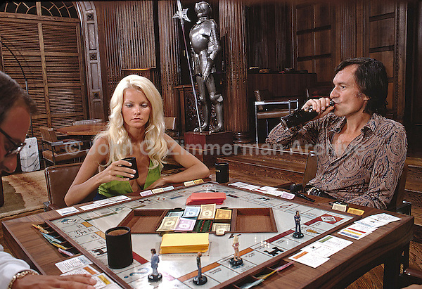 Hugh Hefner and girlfriend Karen Christy play Monopoly at Hefner's Chicago Mansion. 1973. Photo by John G. Zimmerman.