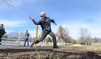 NWA Media/ J.T. Wampler - Ray Moore of Fayetteville tees off Thursday Dec. 25, 2014 while playing disc golf with friends at Northshore Disc Golf Course along the north side of Lake Fayetteville. The course is open to the public and free to play all year.