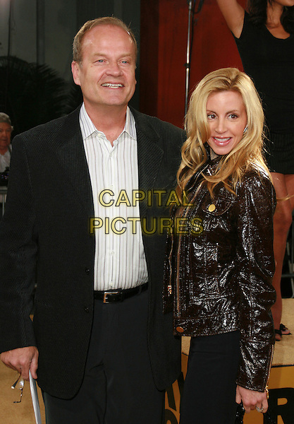 "KELSEY GRAMMER & CAMILLE GRAMMER.""Rocky Balboa"" Premiere held at Mann's Chinese Theater, Hollywood, California, USA..December 13th, 2006.half length black suit jacket brown leather husband wife married.CAP/ADM/CH.©Charles Harris/AdMedia/Capital Pictures"