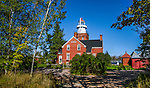 A view from the back of the beautiful Big Bay Point Lighthouse as it looks toward Lake Superior on an autumn morning, Michigan, Upper Peninsula, USA