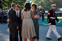 US President Barack Obama (L), First Lady Michelle Obama (2R) greet Italian Prime Minister Matteo Renzi (2L) and Italian First Lady Agnese Landini (R) as they arrive to an official arrival ceremony on the South Lawn of the White House in Washington DC, USA, 18 October 2016. Later today President Obama and First Lady Michelle Obama will host their final state dinner featuring celebrity chef Mario Batali and singer Gwen Stefani performing after dinner. <br /> Credit: Shawn Thew / Pool via CNP /MediaPunch