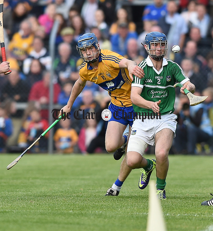 Bobby Duggan of Clare in action against Mark O Callaghan of Limerick during their U-21 Munster final in Cusack Park. Photograph by John Kelly.