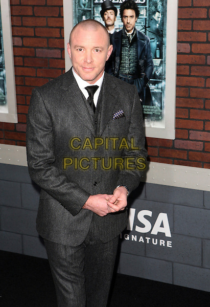 "GUY RITCHIE .At the New York City Premiere of ""Sherlock Holmes"" held at Alice Tully Hall, New York, NY, USA, 17th December 2009..half length grey gray suit black tie wool  .CAP/ADM/PZ.©Paul Zimmerman/Admedia/Capital Pictures"