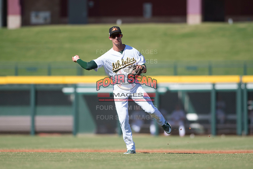 Mesa Solar Sox shortstop Eli White (21), of the Oakland Athletics organization, makes a running throw to first base during an Arizona Fall League game against the Surprise Saguaros at Sloan Park on November 1, 2018 in Mesa, Arizona. Surprise defeated Mesa 5-4 . (Zachary Lucy/Four Seam Images)