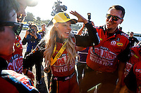 Feb 12, 2017; Pomona, CA, USA; NHRA top fuel driver Leah Pritchett celebrates with her crew after winning the Winternationals at Auto Club Raceway at Pomona. Mandatory Credit: Mark J. Rebilas-USA TODAY Sports