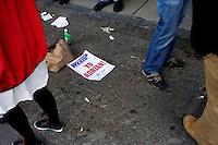 Discarded K cards litter the ground outside Fenway Park during the 2011 season opener in Boston, Massachusetts, USA.