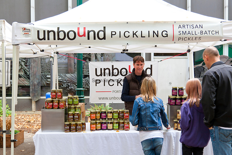 The Portland Farmers' Market in the South Park Blocks on Saturday mornings. Unbound Pickling features pickled everything from okra to bacon smoked pickles.  Owner Jesse Hancock and his wife Katie moved to Portland from Idaho for the access to fresh produce.