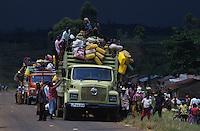 Villagers loading trucks