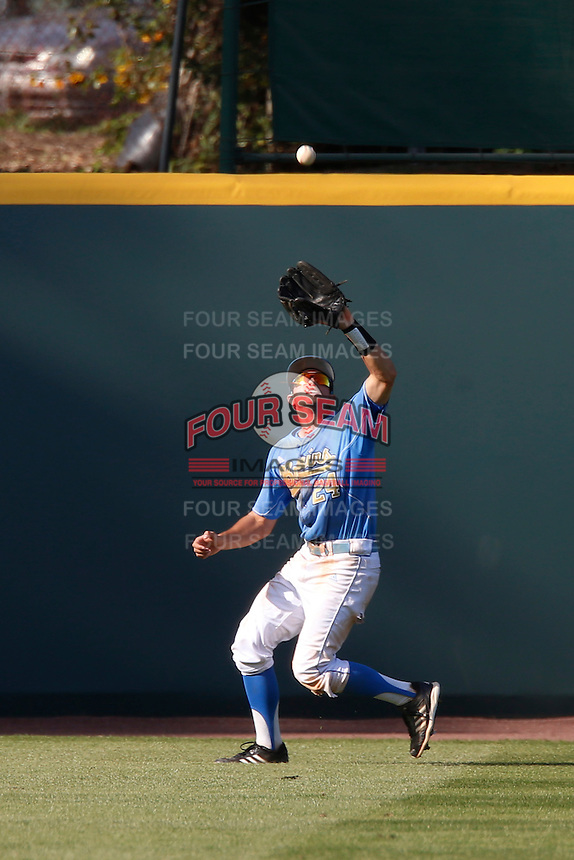 Brian Carroll #24 of the UCLA Bruins catches a fly ball against the California Golden Bears at Jackie Robinson Stadium on March 23, 2013 in Los Angeles, California. (Larry Goren/Four Seam Images)