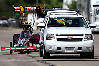 Sep 28, 2013; Madison, IL, USA; A tow vehicle tows NHRA top fuel dragster driver Steve Torrence during qualifying for the Midwest Nationals at Gateway Motorsports Park. Mandatory Credit: Mark J. Rebilas-