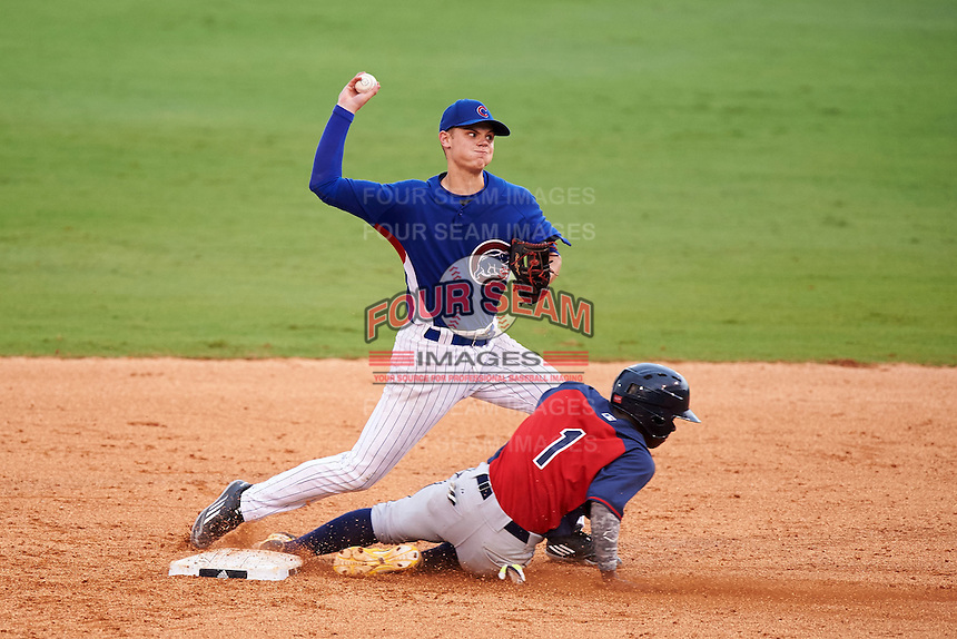 Logan Goodnight (52) of Linsly High School in Wheeling, West Virginia throws to first as EP Reese (1) slides in while playing for the Chicago Cubs scout team during the East Coast Pro Showcase on July 29, 2015 at George M. Steinbrenner Field in Tampa, Florida.  (Mike Janes/Four Seam Images)