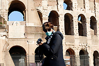 The Coliseum is closed to the public. Few tourists withs masks around <br /> Rome March 10th 2020. Rome the day after the last Minister Council's decree, that extends the restrictions from North of Italy to the entire country to contain Covid-19 Virus. All the shops (restaurants, pubs, and even supermarkets) will have to close at 6 pm. Gathering of people will be forbitten and people will have to maintain the 1 meter security distance. Citizens are furthermore invited to stay at home with the exception of people who have to go to work, to the pharmacy or to the supermarket.<br /> Photo Samantha Zucchi Insidefoto
