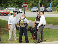 NWA Democrat-Gazette/ANDY SHUPE<br /> Officers and detectives with the Fayetteville Police Department gather Tuesday, Sept. 8, 2015, outside the Northwest Arkansas Federal Credit Union in Fayetteville after a robbery was reported.