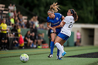 Seattle, WA - Saturday, July 02, 2016: Seattle Reign FC midfielder Lindsay Elston (6) and Boston Breakers defender Mollie Pathman (20) collide during a regular season National Women's Soccer League (NWSL) match between the Seattle Reign FC and the Boston Breakers at Memorial Stadium. Seattle won 2-0.