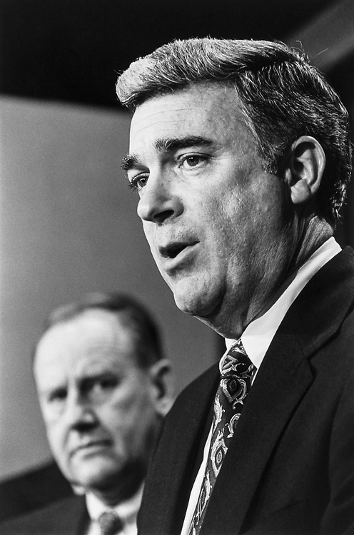 Rep. Matthew F. McHugh, D-N.Y. with Rep. James V. Hansen, R-Utah at a press conference regarding House Bank Abusers, along with other standards of official conduct committee in 1992. (Photo by Maureen Keating/CQ Roll Call)