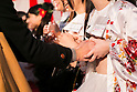 A man squeezes the breast of an adult movie star during the 13th annual 24 hour TV event ''Eroticism Saves the Earth Telethon'' on December 6, 2015 in Tokyo, Japan. 7 adult movie actresses donated their breasts for a 24 hour telethon event with the aim of raising money for a Stop AIDS charity. This year Japanese actresses collected 6,144,567 JPN (49,909 USD) approximately from 7,175 fans which was donated to an AIDS charity. The 13th annual 24 hour TV event ''Eroticism Saves the Earth Telethon'' was organized by Sky Perfect TV Adult Chanel under the slogan ''Social contribution whilst enjoying the erotic''. Fans were given the chance to interact with some of the channel's leading actresses in the live broadcast event that ran from Saturday afternoon through until Sunday. (Photo by Rodrigo Reyes Marin/AFLO)