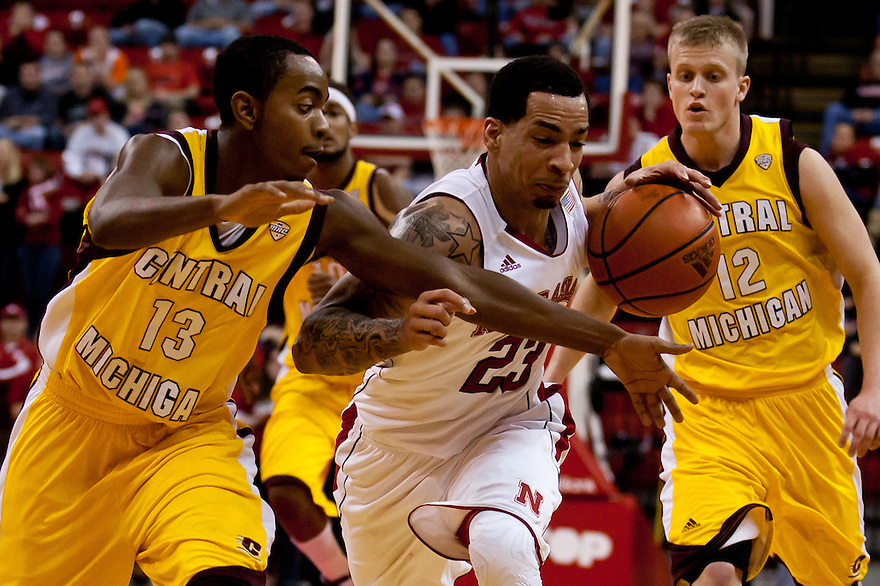20 December 2011: Bo Spencer #23 of the Nebraska Cornhuskers drives through John Morris #13 of the Central Michigan Chippewas during the second half at the Devaney Sports Center in Lincoln, Nebraska. Nebraska defeated Central Michigan 72 to 69.