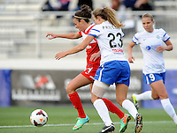 Boyds MD - April 19, 2014: Jodie Taylor (14) of the Washington Spirit  goes against Nikki Phillips (23) of FC Kansas City. The Washington Spirit defeated the FC Kansas City 3-1 during a regular game of the 2014 season of the National Women's Soccer League at the Maryland SoccerPlex.