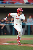 Evan Mendoza (18) of the North Carolina State Wolfpack hustles down the first base line against the Louisville Cardinals at Doak Field at Dail Park on March 24, 2017 in Raleigh, North Carolina. The Wolfpack defeated the Cardinals 3-1. (Brian Westerholt/Four Seam Images)