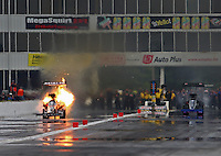 May 17, 2014; Commerce, GA, USA; NHRA top fuel dragster Terry McMillen (left) explodes his engine racing alongside Pat Dakin during qualifying for the Southern Nationals at Atlanta Dragway. Mandatory Credit: Mark J. Rebilas-USA TODAY Sports
